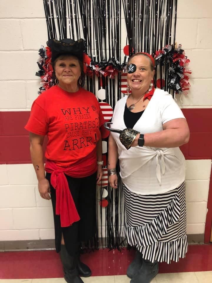 Kindergarten teachers celebrating Pirate Day at school.