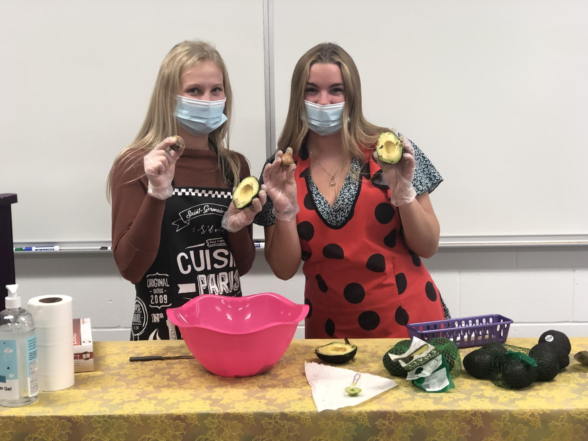 Two Students making Guacamole