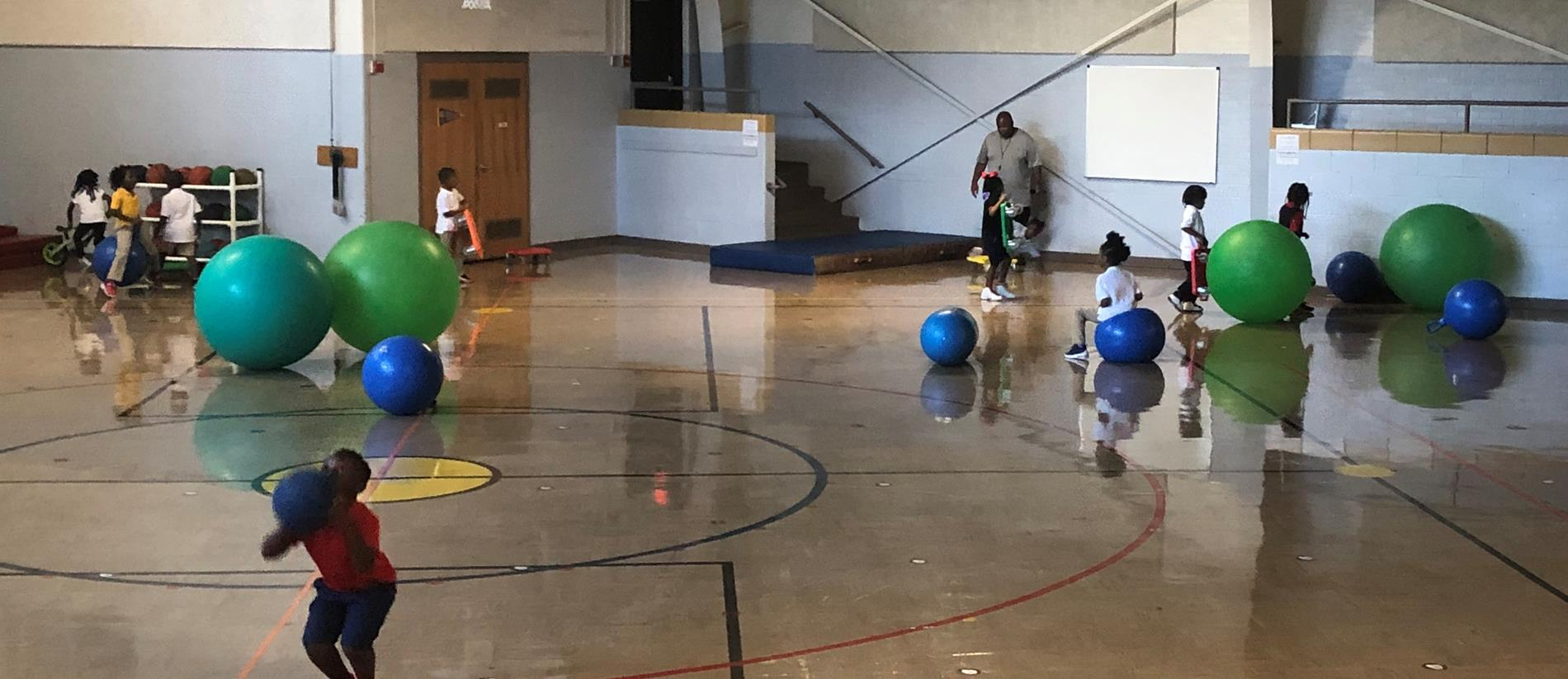 Kiddos enjoying Gym time with Coach Fry