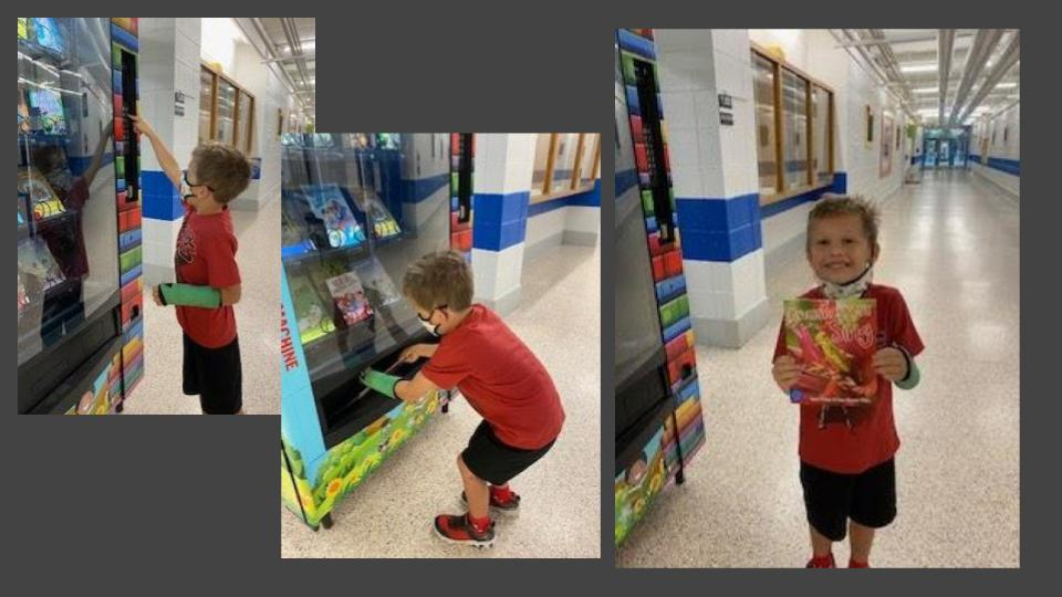 child getting book from vending machine
