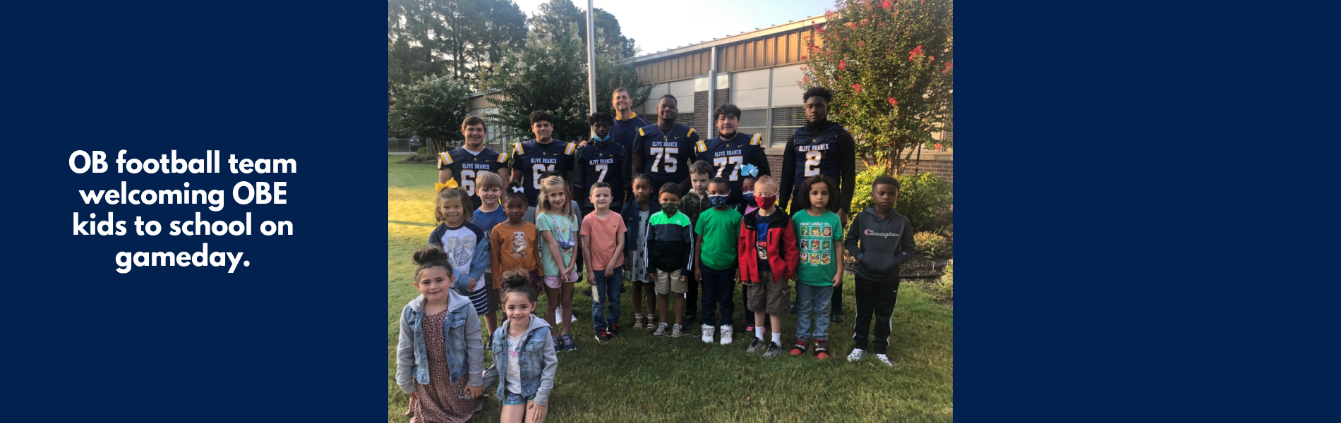 Football players greet OBE students on game day