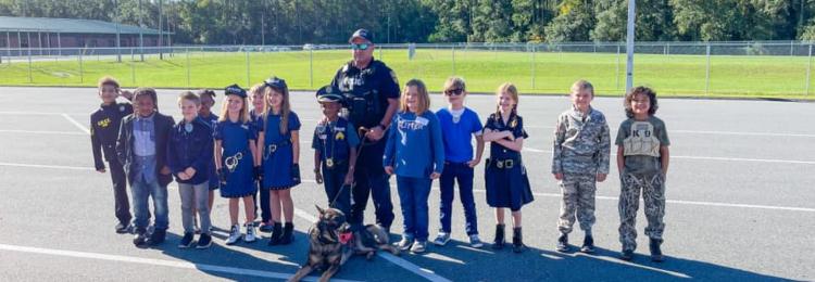 Students, deputy and K( dog