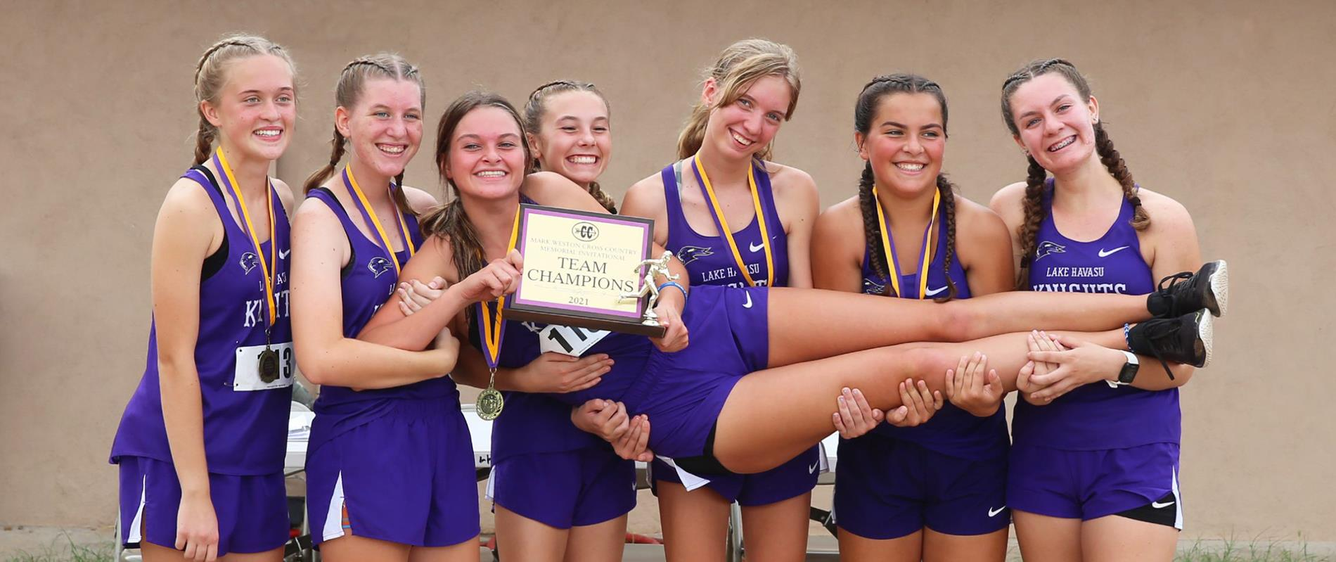 Girls Track team with team trophy