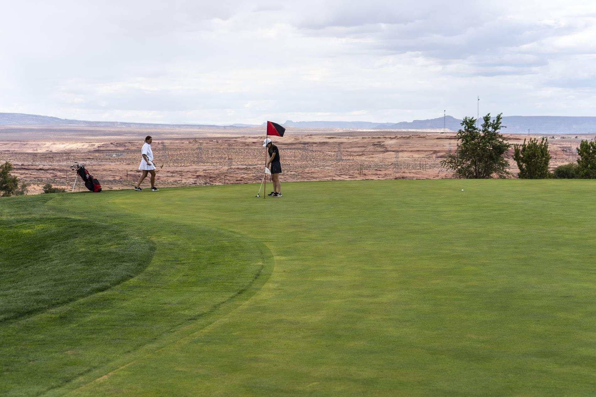 photo of girls playing golf