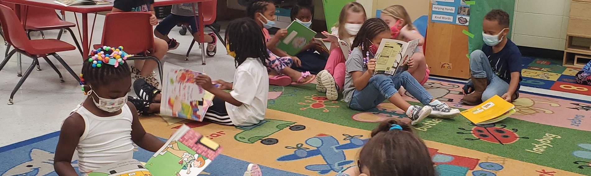 students reading on a classroom carpet