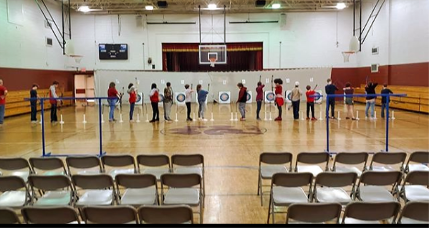 archery team lined up to shoot