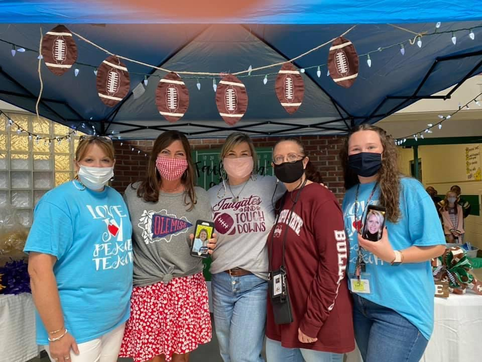 Teachers at the tailgate.