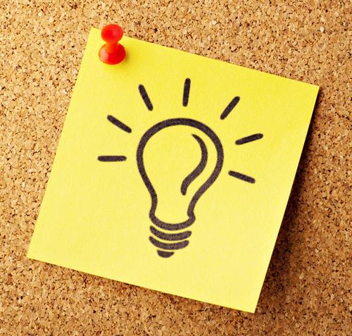 idea lightbulb drawn on a yellow sticky note