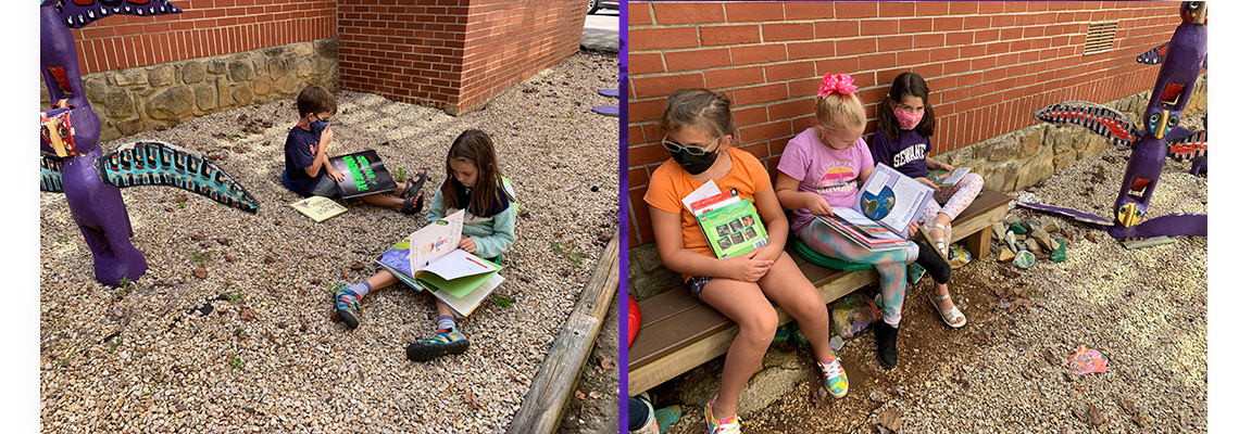 students outdoors reading