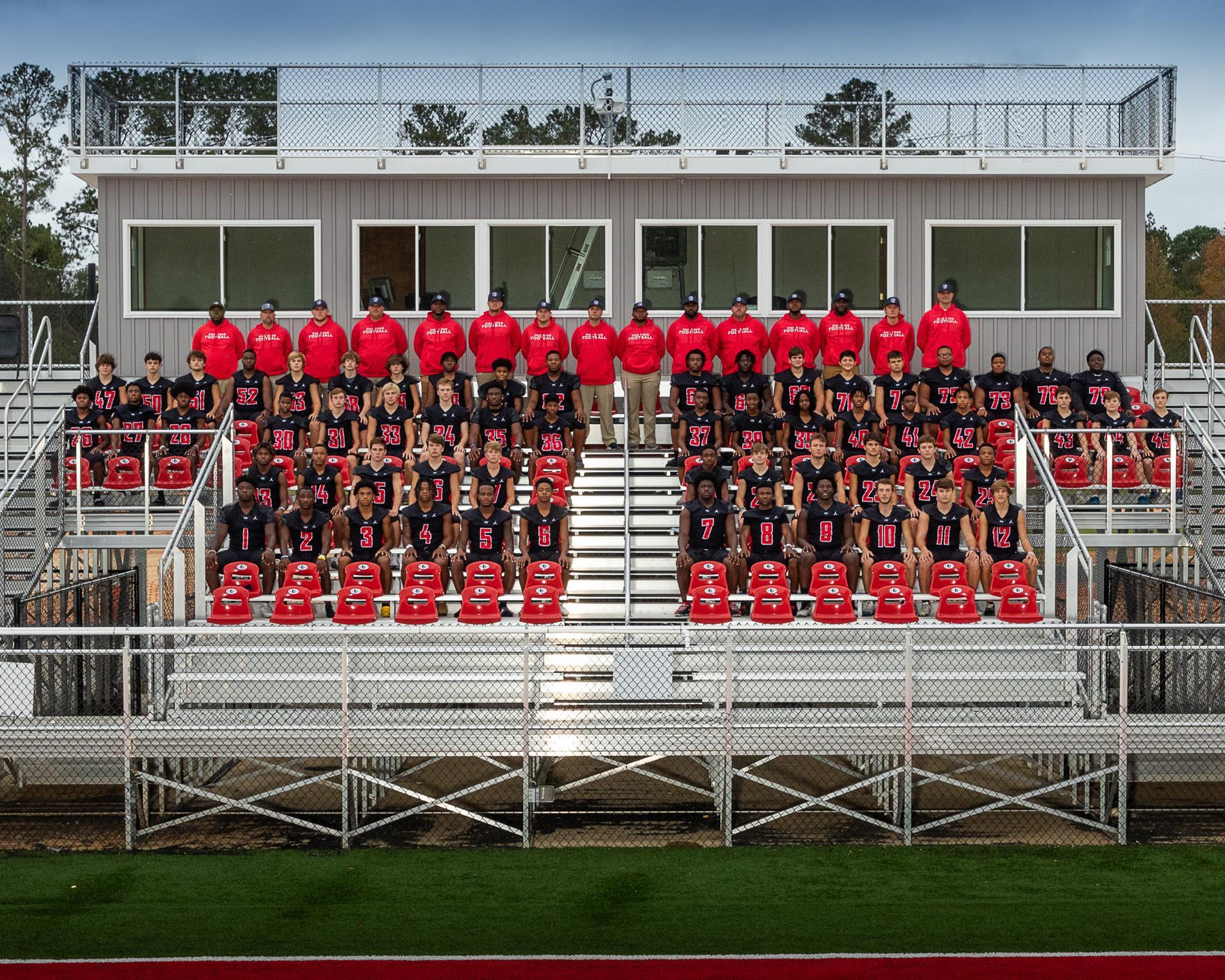 Football Varsity team sitting on bleachers